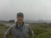 On the run - early in light rain. Golden gate bridge in the back ground (behind the clouds)