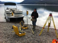 Jacon from River Design setting up the GPS base station on shore